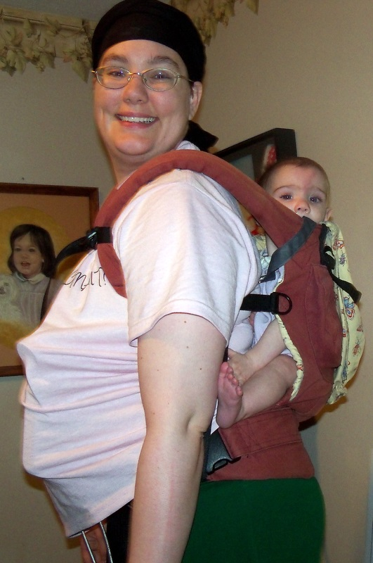 pumping and babywearing; getting ready to start up the knitting machine